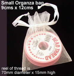 reel in a small organza bag